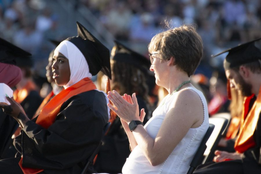 Senior Maryam Abdirahman celebrates speakers during graduation June 8. The Park commencement ceremony was held on the turf field.