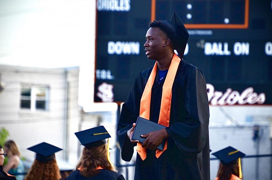 Graduate Paris Johnson Jr. walks up the aisle after getting his diploma June 8. Park graduated 370 students this year for the biggest graduating class in 20 years.