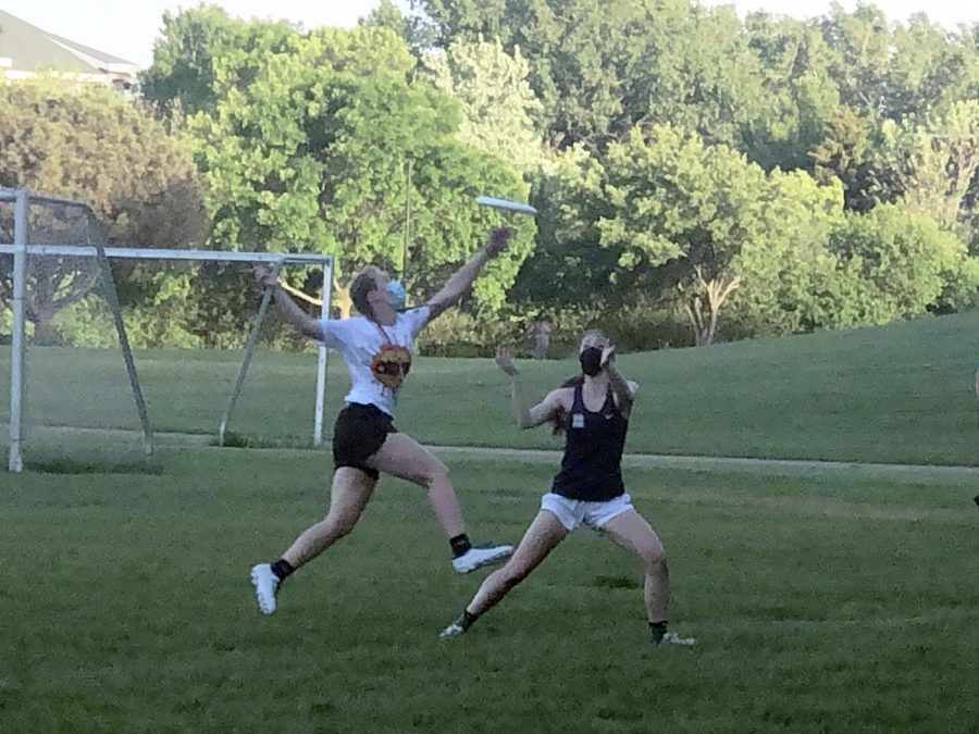 Senior Elizabeth Kniser knocks the disc away from an opponent May 25. The team lost by one in overtime.