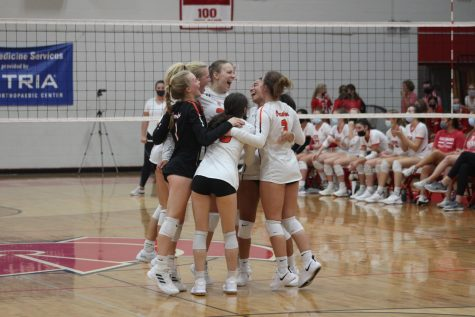 Girls volleyball huddles after winning a point Sept. 14.  Park lost to Benilde-St. Margarets 3-0.