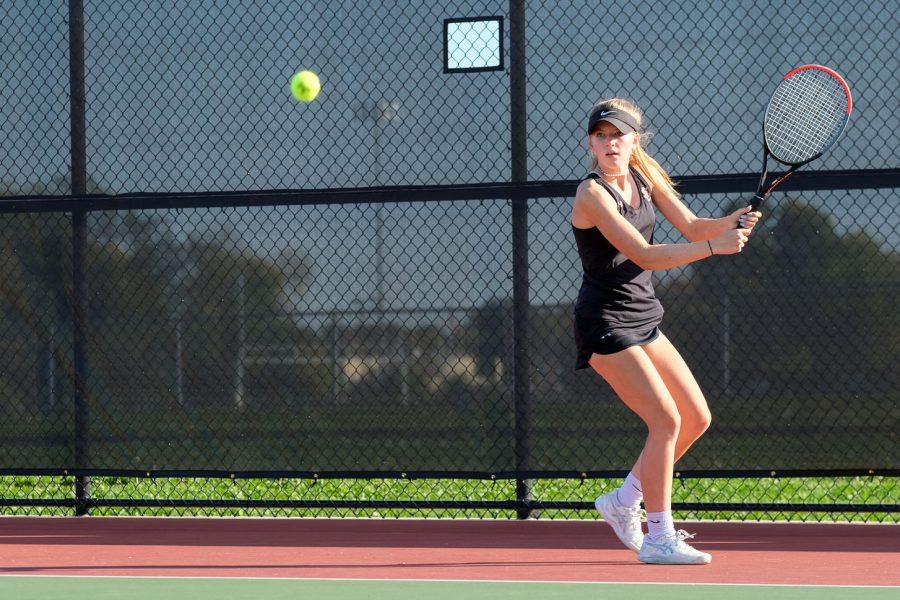 Junior Kamryn Halley hits the tennis ball during a match against Benilde Sept. 21. Park lost the match 0-7.