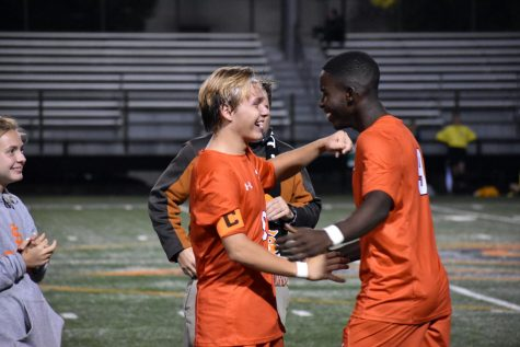 Seniors Jovan Dennison and Claudy Zua go in for a hug Sept. 20. Park held their senior night celebration during halftime.