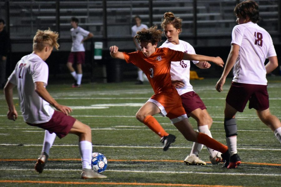 Junior Issac Cantor goes to steal the ball from the opposing team Sept. 20. Park's next game is 1:00 p.m. Sept. 25 at Eden Prairie High School.
