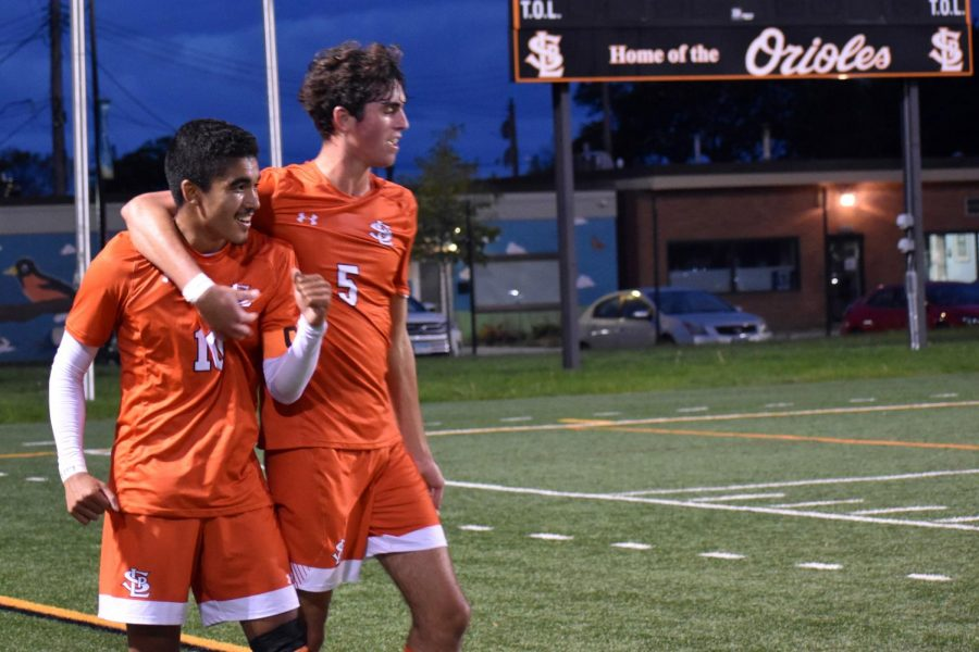 Senior captains Bennet Kouame and Nick Kent congratulate each other Sept. 20. Kouame and Kent scored two of the five goals.