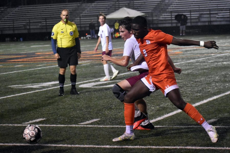 Senior Claudy Zua fights the opposing team for the ball Sept. 20. Park has a current record of 7-1-0.