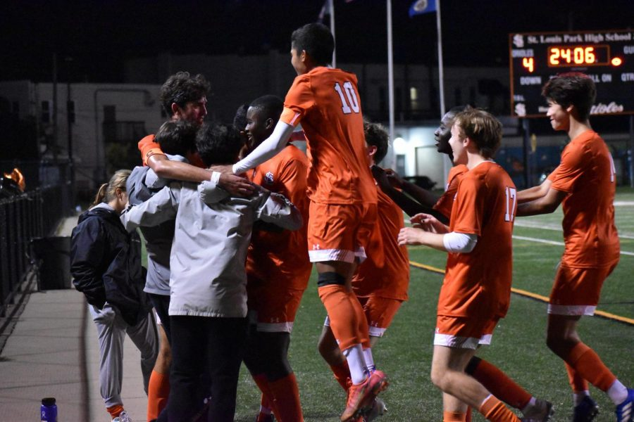 The boys soccer team celebrates their win Sept. 20. Park has 8 games left in the season.