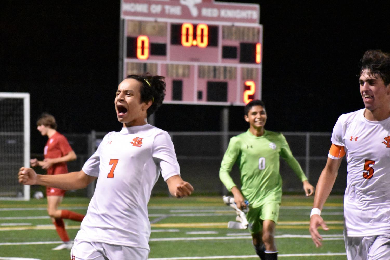 Freshman Johnny Ryan cheers after winning the game Sept. 14. Park won 1-0 against Benilde-St. Margaret's.