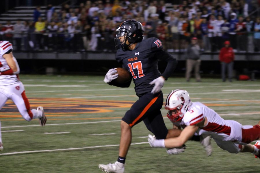 Senior Marcus Hosfield endures running as he is tackled. The stadium sat in silence after Hosfield was hurt during the third quarter.
