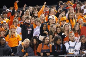 Students cheer on the football team Sept. 25. The week was full of dress codes for the students and staff, ending on a Park Pride dress code for the Homecoming game.