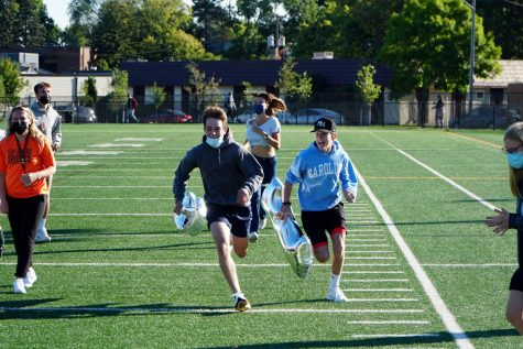 Senior Tait Myers and junior Miles Rider race to the finish line Sept. 9. The race featured two students from each grade.