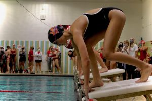 Sophomore Carys Searle prepares for a race against Benilde on Sept. 14. Despite their valiant effort the team lost the meet.