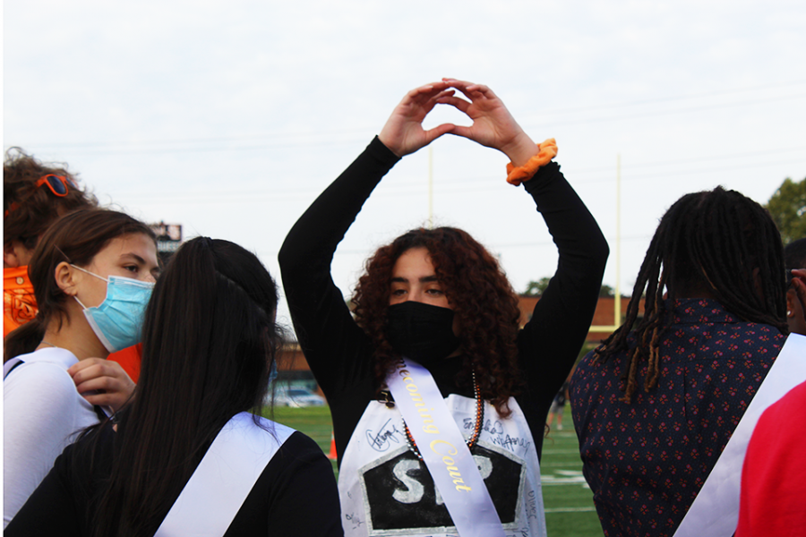Senior Sophia Romero celebrates as the Homecoming royalty gathers on the field Sept. 24. Homecoming royalty was crowned at the pep fest.