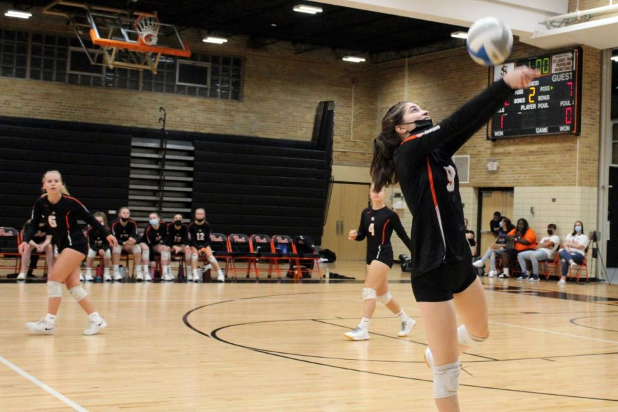 Senior Elsa Bergland jumps above the net to spike the ball Sept. 29. Girls' volleyball beat Robbinsdale Armstrong 3-1.