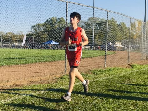 Freshman Caleb Teichman pushes past his limits in the boys JV 5,000 meter race. His team finished in 12th place.