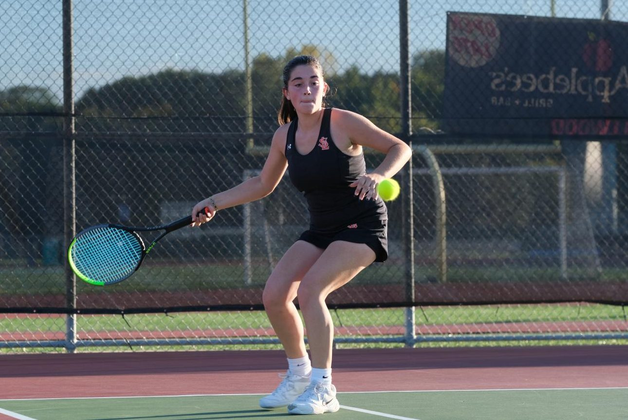 Junior Lily Fadell hits a tennis ball at sections tournament Oct. 5. Park won against Hopkins during their first sections match 5-2.