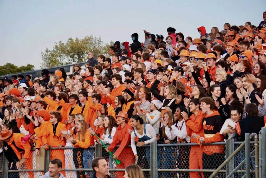 Student section cheers after a touchdown while wearing the all-orange dress code Sept. 24. Park won its homecoming game against crosstown rival Benilde St. Margaret.