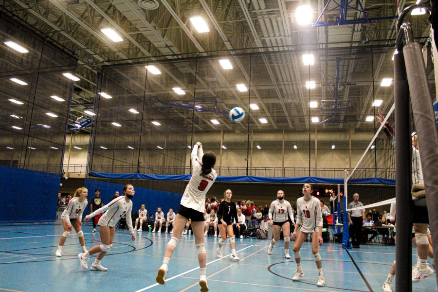Senior Elsa Bergland bumps the ball over the net during the team's first game at the St. Michael-Albertville state tournament. Park lost 0-3 against Southwest Christian High School Oct. 15.