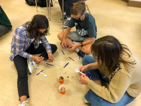 Senior Ella Runyan works with her team to build a gummy bear tower at German Clubs meeting Oct. 6. Contests also include a gummy bear race, catapults and trivia