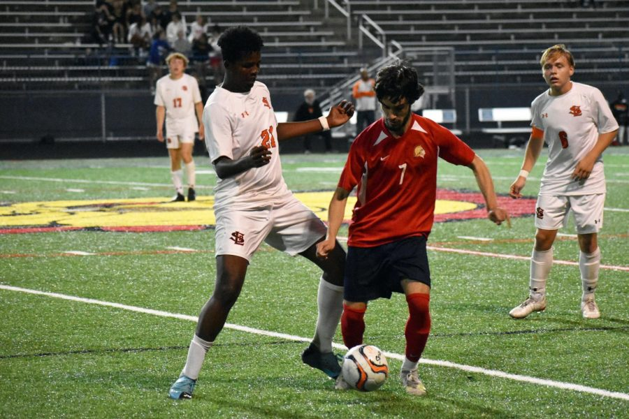 Junior Yahya Abdille and Orono senior Brady Cook battle for the ball Oct. 5. Park has one game left in the regular season against Minneapolis Washburn.