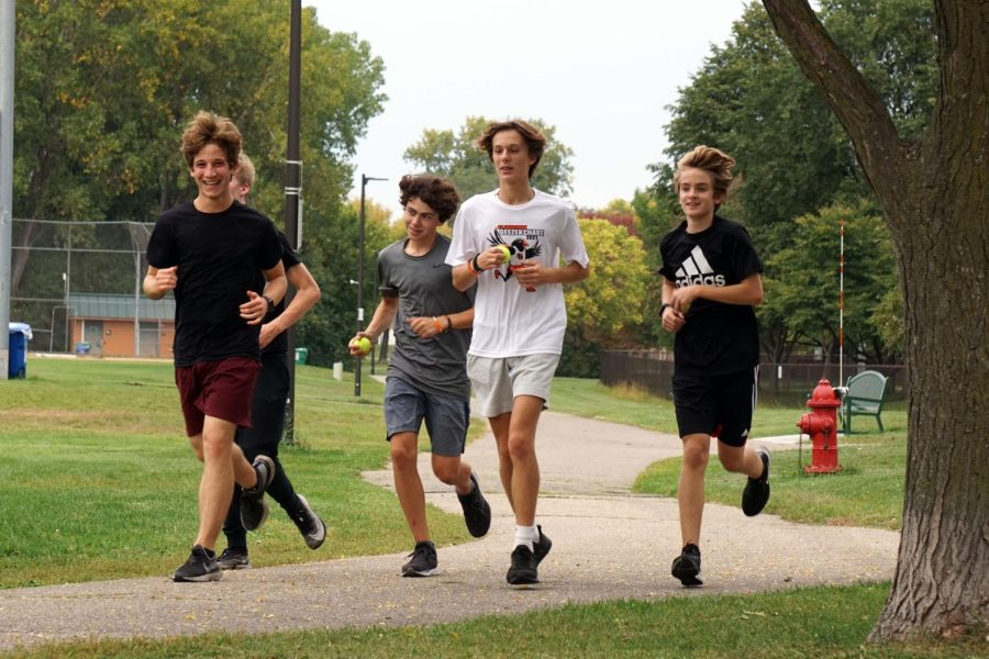Varsity runners run during practice Sept. 29. The cross country team will face St. Michaels at 4 p.m. Oct. 4 at St. Michael Recreation Center.