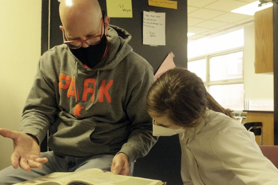 Club adviser Dan Ruzek and student Hera Roush discuss game strategies during a Dungeons and Dragons meeting Oct. 11. Dungeons and Dragons meets in A305 after school Mondays and Wednesdays.