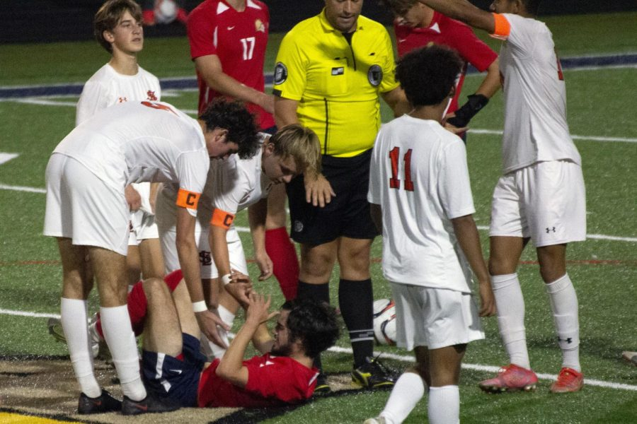 Senior captains Nick Kent and Jovan Dennison help opposing player to stand up and continue playing Oct. 5. Park is now awaiting section seeding.