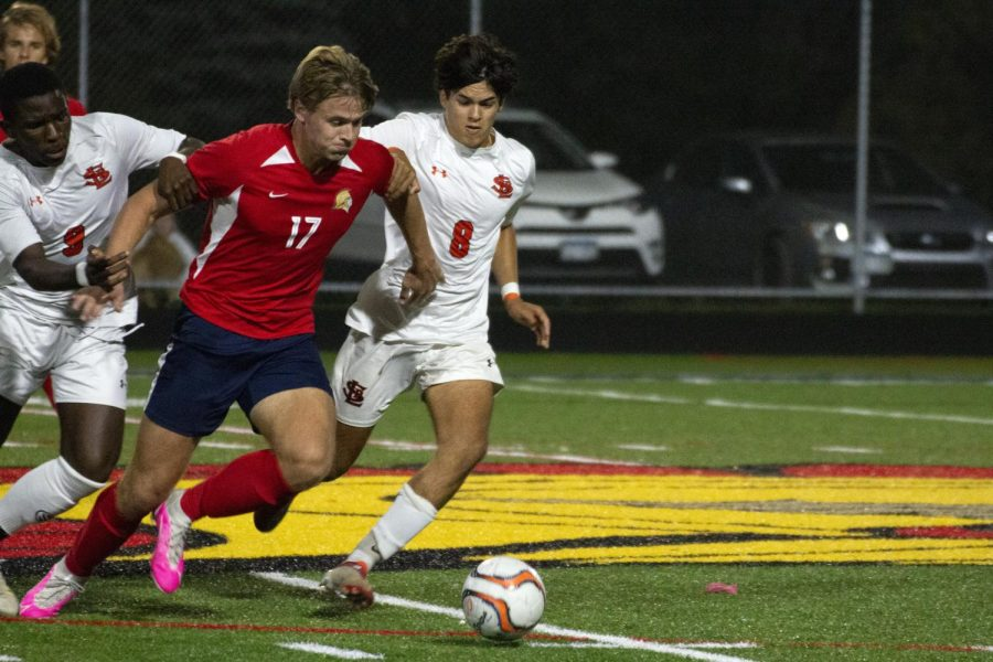 Senior Claudy Zua and sophomore Luca Guarin steal the ball from Orono defender Oct. 5. Parks next game will be against Minneapolis Washburn.