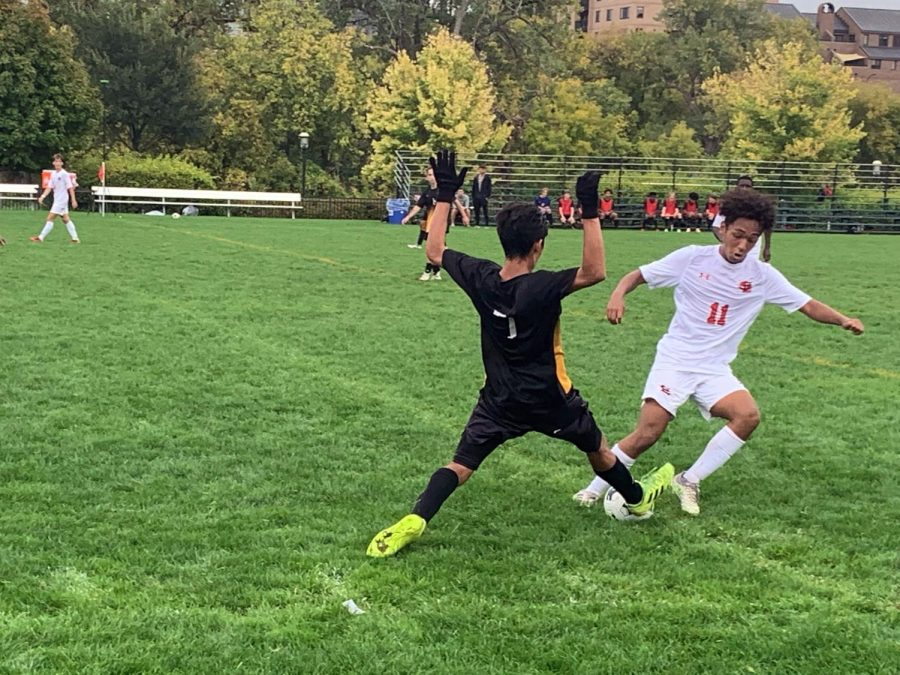 Junior Amanuel Shetaye fights for the ball with a DeLaSalle player. Parks 9-game winning streak was halted as DeLaSalle won the match 2-0.