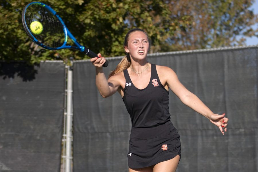 Senior Ava Jacobson returns a serve Oct. 5. Park won against Hopkins during their first sections match.
