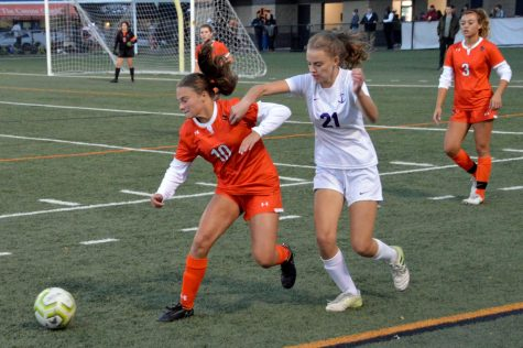 Junior Anna Williams fights for the ball in a sections game against Southwest Oct. 14. Park won the matchup 1-0 in overtime.